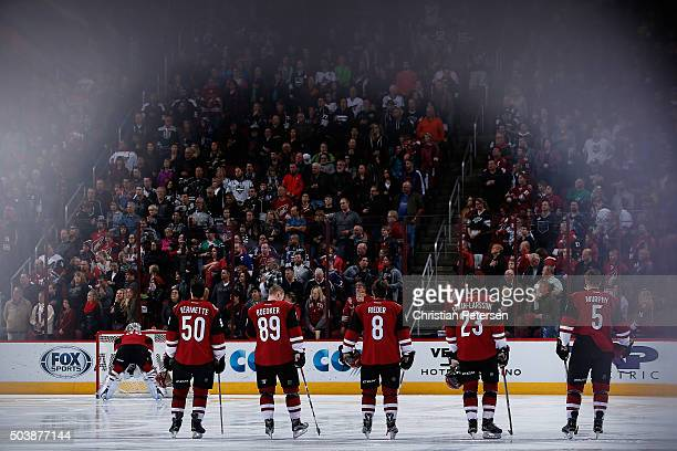 Goaltender Louis Domingue Antoine Vermette Mikkel Boedker Tobias Rieder Oliver EkmanLarsson and Connor Murphy of the Arizona Coyotes stand attended...