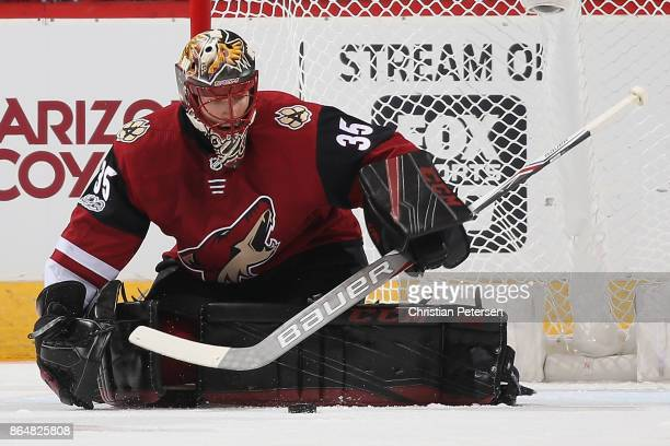 Goaltender Louis Domingue of the Arizona Coyotes makes a pad save on a shot from the Chicago Blackhawks during the first period of the NHL game at...