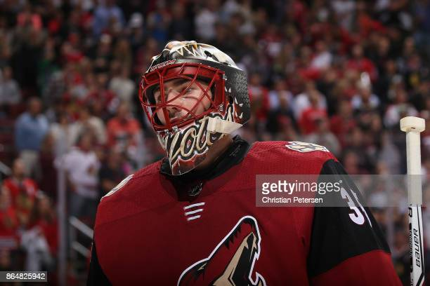 Goaltender Louis Domingue of the Arizona Coyotes reacts after a penalty shot from the Chicago Blackhawks during the second period of the NHL game at...