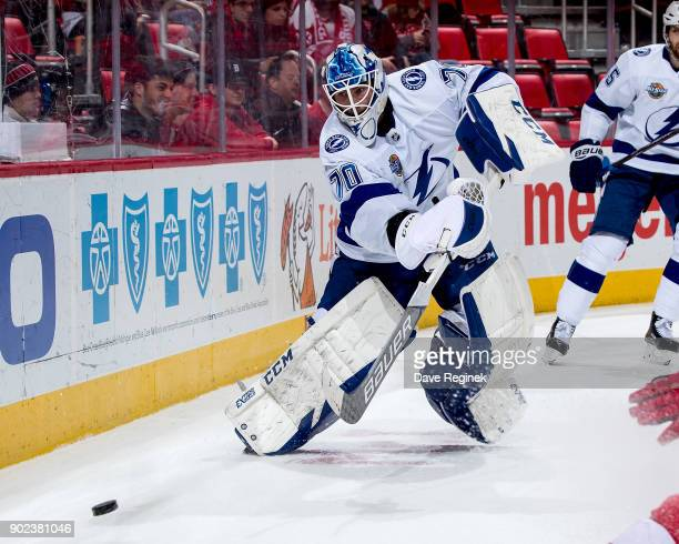 Goaltender Louis Domingue of the Tampa Bay Lightning clears the puck behind the net during an NHL game against the Detroit Red Wings at Little...