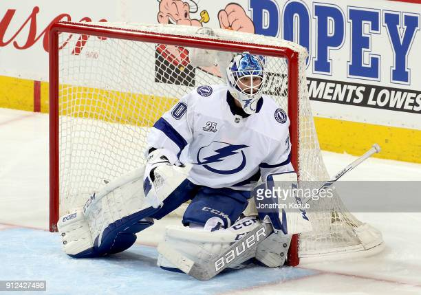 Goaltender Louis Domingue of the Tampa Bay Lightning guards the net during second period action against the Winnipeg Jets at the Bell MTS Place on...