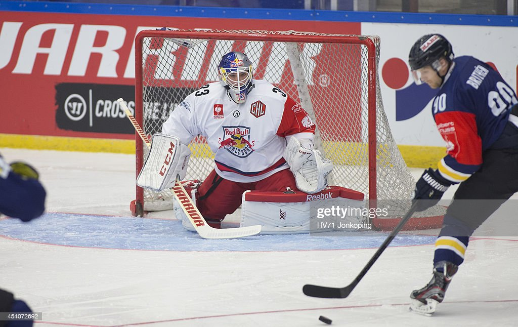 Goaltender Luka Gracnar #33 of Salzburg makes a save as Ted Brithén #90 of HV71 shots at goal during the Champions Hockey League group stage game between HV71 Jonkoping and Red Bull Salzburg on August 24, 2014 in Jonkoping, Sweden.