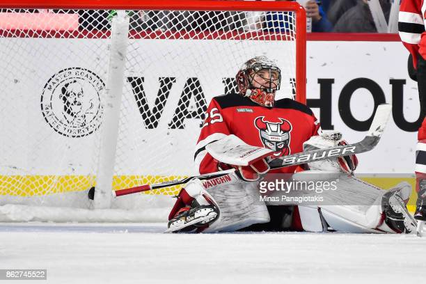 Goaltender Mackenzie Blackwood of the Binghamton Devils sits on the ice after allowing a first period goal against the Laval Rocket during the AHL...