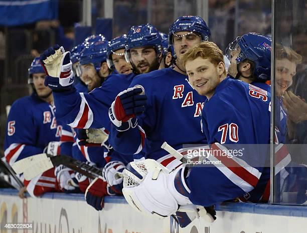 Goaltender Mackenzie Skapski of the New York Rangers celebrates a goal against the Dallas Stars at Madison Square Garden on February 8 2015 in New...