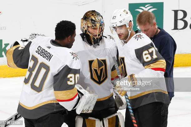 Goaltender Malcolm Subban and Max Pacioretty congratulate Goaltender MarcAndre Fleury of the Vegas Golden Knights after the 72 win against the...