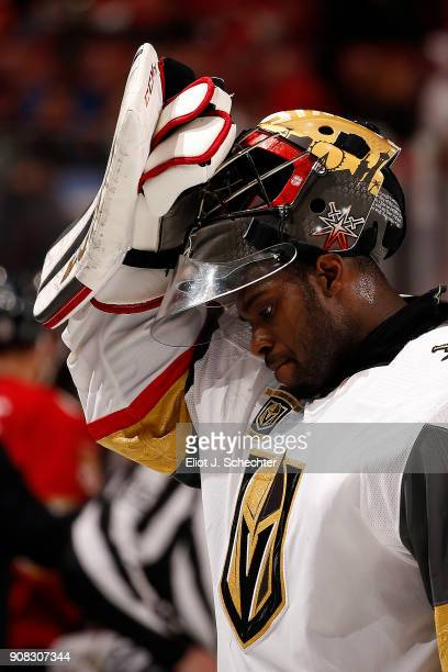 Goaltender Malcolm Subban of the Vegas Golden Knights pulls his helmet back on after a break in the action against the Florida Panthers at the BBT...