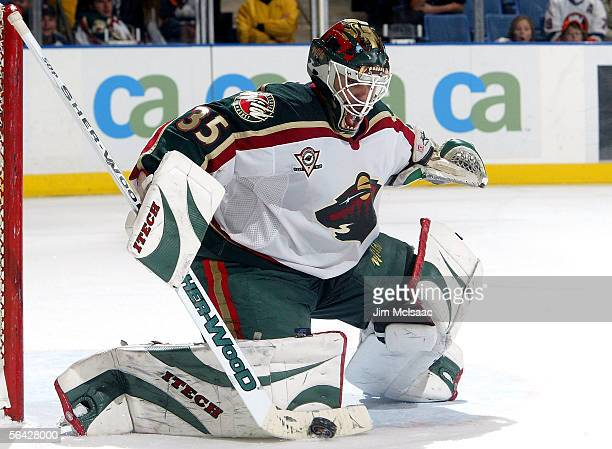 Goaltender Manny Fernandez of the Minnesota Wild makes a save against the New York Islanders on December 13, 2005 at Nassau Coliseum in Uniondale,...