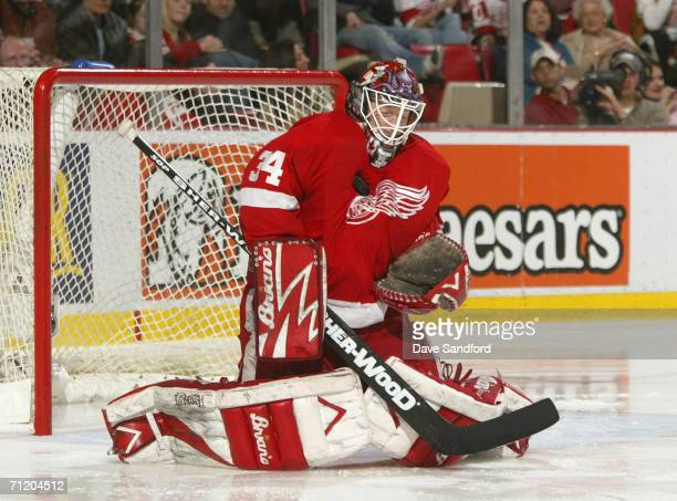 Goaltender Manny Legace of the Detroit Red Wings stops the puck during the NHL game against the Edmonton Oilers at Joe Louis Arena April 11 2006 in...