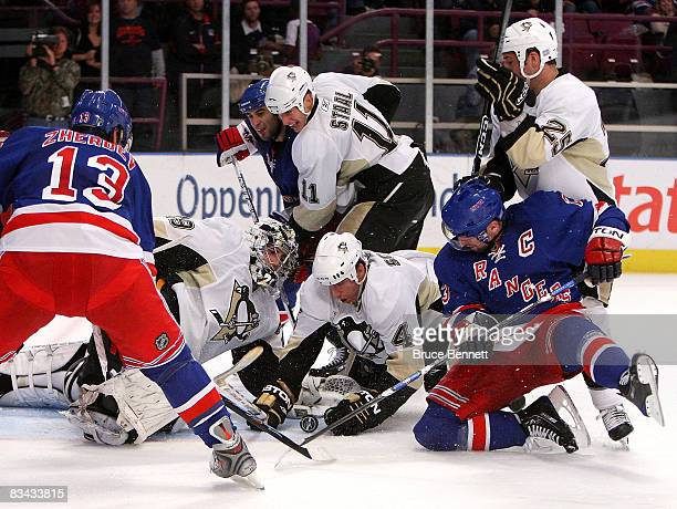 Goaltender Marc-Andre Fleury and defenseman Rob Scuderi of the Pittsburgh Penguins combine to stop Nikolai Zherdev and Chris Drury of the New York...