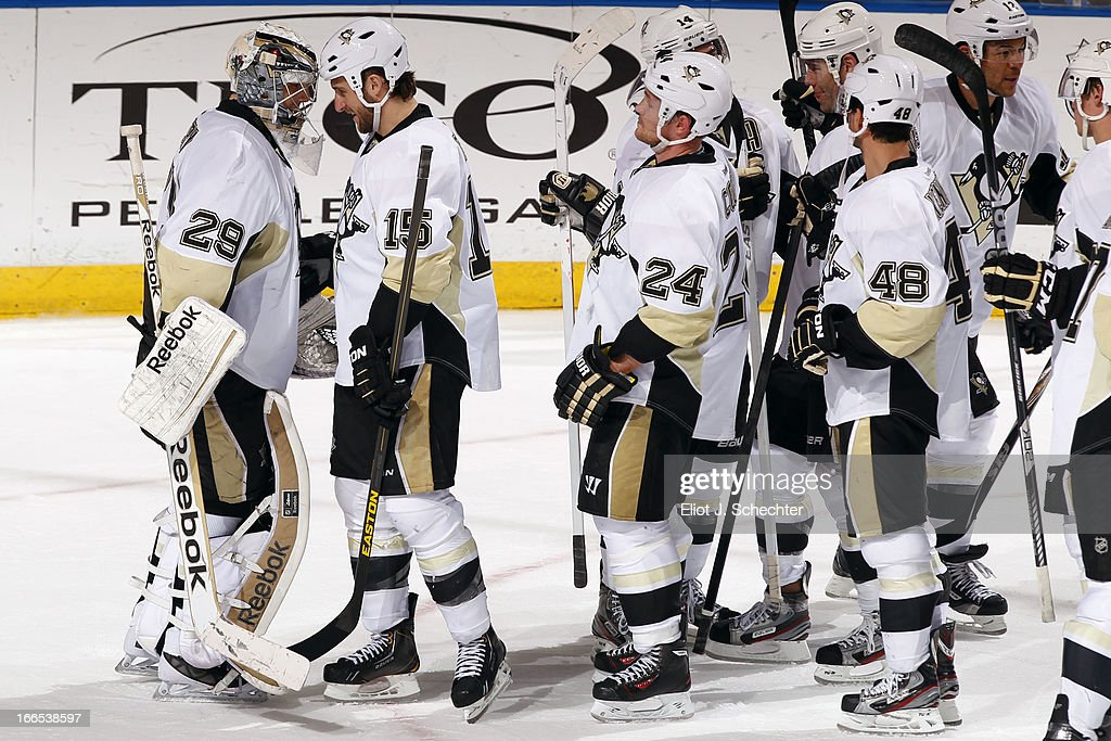 Goaltender Marc-Andre Fleury #29 of the Pittsburgh Penguins celebrates their win with teammate Tanner Glass #15 against the Florida Panthers at the BB&T Center on April 13, 2013 in Sunrise, Florida.