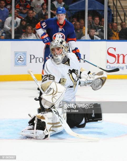 Goaltender Marc-Andre Fleury of the Pittsburgh Penguins defends his net against the the New York Islanders on October 3, 2009 at Nassau Coliseum in...