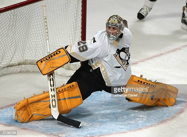 Goaltender MarcAndre Fleury of the Pittsburgh Penguins makes a pad save during a game against the Chicago Blackhawks on October 30 2003 at the United...
