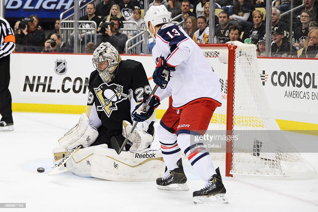 Goaltender Marc-Andre Fleury #29 of the Pittsburgh Penguins makes a save on a shot from Cam Atkinson #13 of the Columbus Blue Jackets in the third period in Game Two of the First Round of the 2014 NHL Stanley Cup Playoffs on April 19, 2014 at CONSOL Energy Center in Pittsburgh, Pennsylvania.
