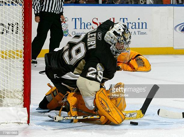 Goaltender Marc-Andre Fleury of the Pittsburgh Penguins makes a stick save against the New York Islanders on November 3, 2007 at Nassau Coliseum in...