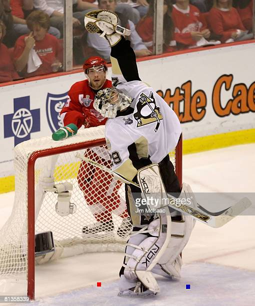 Goaltender MarcAndre Fleury of the Pittsburgh Penguins plays the puck against Brad Stuart of the Detroit Red Wings during game five of the 2008 NHL...