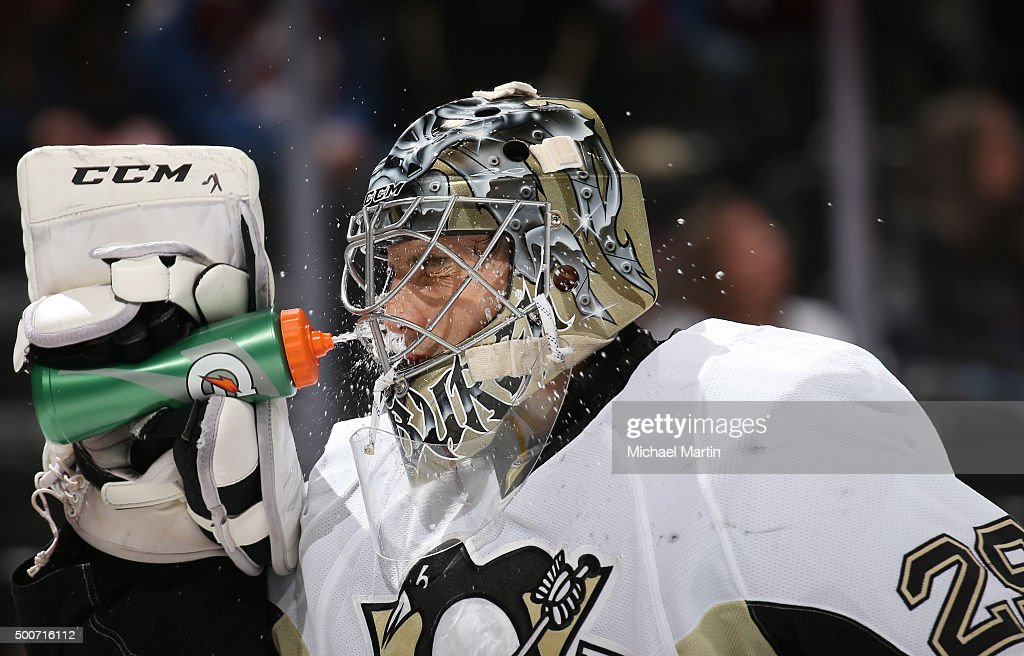 Goaltender Marc-Andre Fleury #29 of the Pittsburgh Penguins sprays himself with water through his mask during a break in the action against the Colorado Avalanche at the Pepsi Center on December 9, 2015 in Denver, Colorado.
