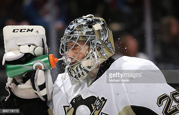 Goaltender MarcAndre Fleury of the Pittsburgh Penguins sprays himself with water through his mask during a break in the action against the Colorado...