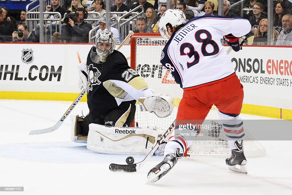 Goaltender Marc-Andre Fleury #29 of the Pittsburgh Penguins stops a shot from Boone Jenner #38 of the Columbus Blue Jackets on a power play in the third period in Game Two of the First Round of the 2014 NHL Stanley Cup Playoffs on April 19, 2014 at CONSOL Energy Center in Pittsburgh, Pennsylvania.