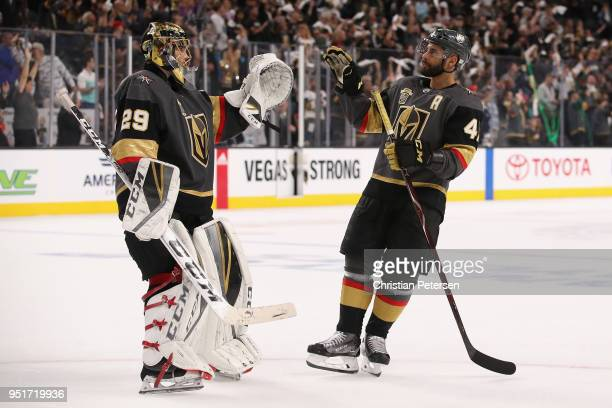 Goaltender MarcAndre Fleury of the Vegas Golden Knights is congratulated by PierreEdouard Bellemare after defeating the San Jose Sharks in Game One...