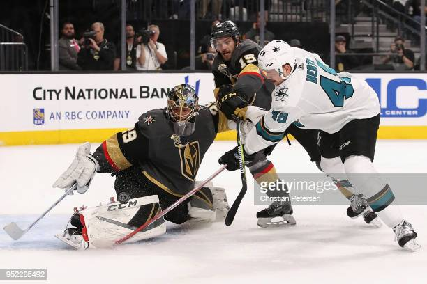 Goaltender MarcAndre Fleury of the Vegas Golden Knights makes a pas save on the shot from Tomas Hertl of the San Jose Sharks as Jon Merrill defends...