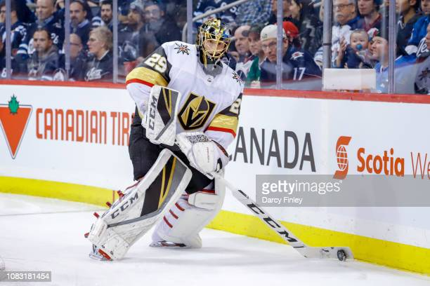 Goaltender MarcAndre Fleury of the Vegas Golden Knights plays the puck along the boards during first period action against the Winnipeg Jets at the...