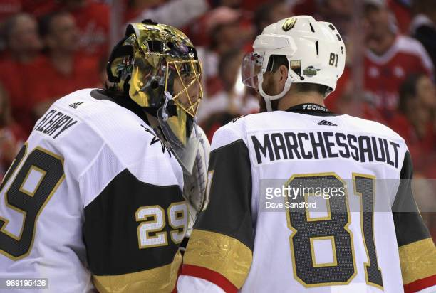 Goaltender MarcAndre Fleury of the Vegas Golden Knights speaks with Jonathan Marchessault during Game Four of the 2018 NHL Stanley Cup Final at...