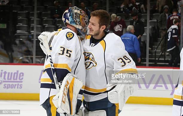 Goaltender Marek Mazanec of the Nashville Predators congratulates Goaltender Pekka Rinne after a win against the Colorado Avalanche at the Pepsi...
