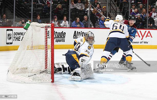 Goaltender Marek Mazanec of the Nashville Predators deflects the puck wide of the net against the Colorado Avalanche at the Pepsi Center on January...