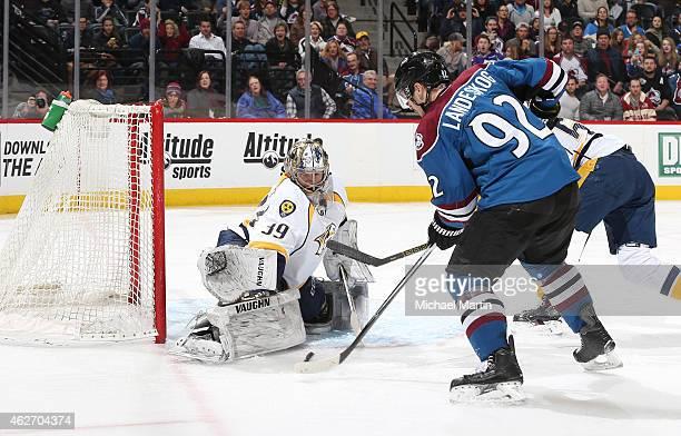 Goaltender Marek Mazanec of the Nashville Predators makes a save against Gabriel Landeskog of Colorado Avalanche at the Pepsi Center on January 30...