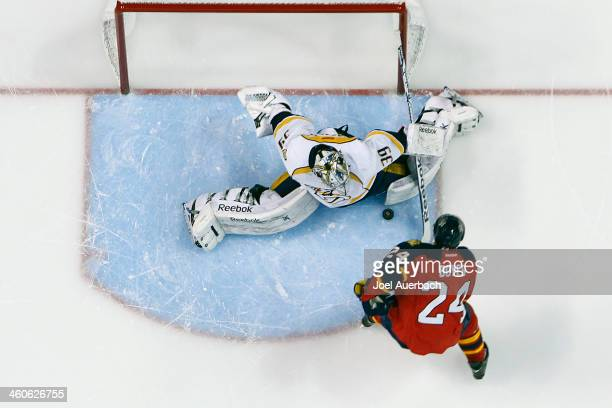 Goaltender Marek Mazanec of the Nashville Predators stops a shot by Brad Boyes of the Florida Panthers during the shootout at the BBT Center on...