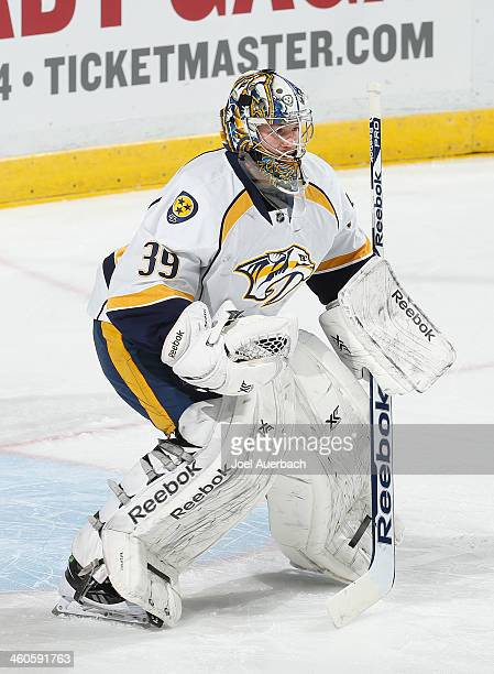 Goaltender Marek Mazanec of the Nashville Predators warms up prior to the game against the Florida Panthers at the BBT Center on January 4 2014 in...