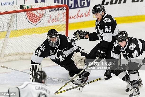 Goaltender Mark Grametbauer of the BlainvilleBoisbriand Armada dives across his net to make a save while teammate TJ Melancon defends during the...