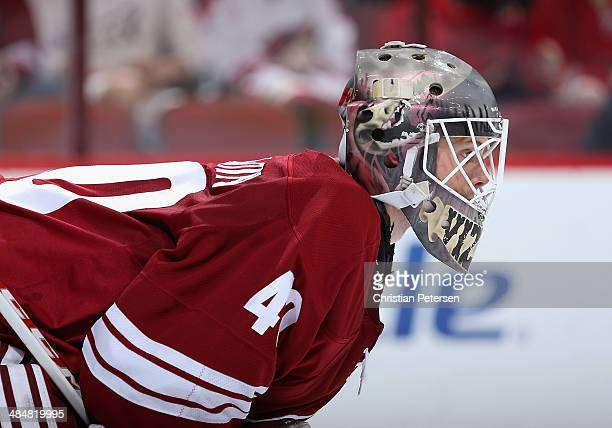 Goaltender Mark Visentin of the Phoenix Coyotes in action during the NHL game against the San Jose Sharks at Jobingcom Arena on April 12 2014 in...