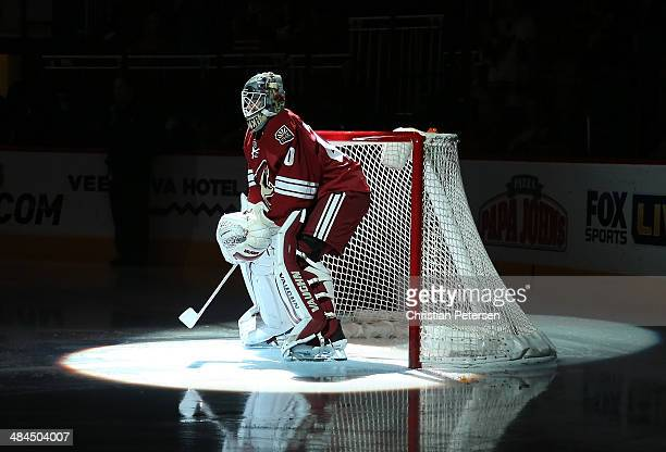 Goaltender Mark Visentin of the Phoenix Coyotes is introduced before the NHL game against the San Jose Sharks at Jobingcom Arena on April 12 2014 in...