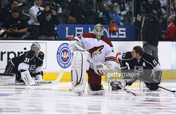 Goaltender Mark Visentin of the Phoenix Coyotes stretches during warmup prior to their NHL game against the Los Angeles Kings at Staples Center on...