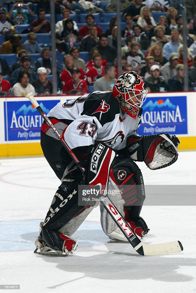 Goaltender Martin Biron #43 of the Buffalo Sabres gets set to make a save during the NHL game against the New York Islanders on October 10, 2002 at HSBC Arena in Buffalo, New York. The Sabres defeated the Islanders 5-1.