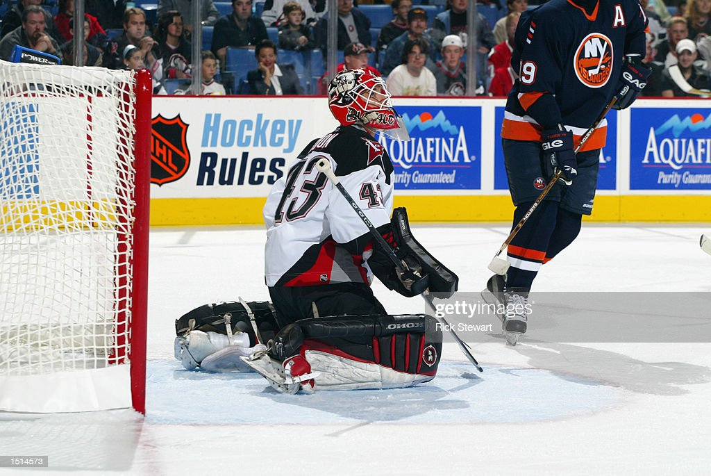 Goaltender Martin Biron #43 of the Buffalo Sabres looks up at the puck during the NHL game against the New York Islanders on October 10, 2002 at HSBC Arena in Buffalo, New York. The Sabres defeated the Islanders 5-1.