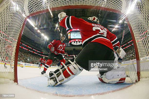 Goaltender Martin Brodeur and defenseman Colin White of the New Jersey Devils guard the net against the Buffalo Sabres on January 8 2008 at the...