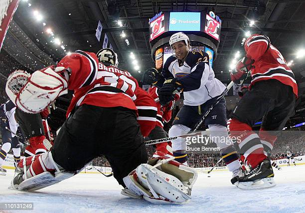 Goaltender Martin Brodeur and Mark Fayne of the New Jersey Devils defend the net against Anthony Stewart of the Atlanta Thrashers at the Prudential...