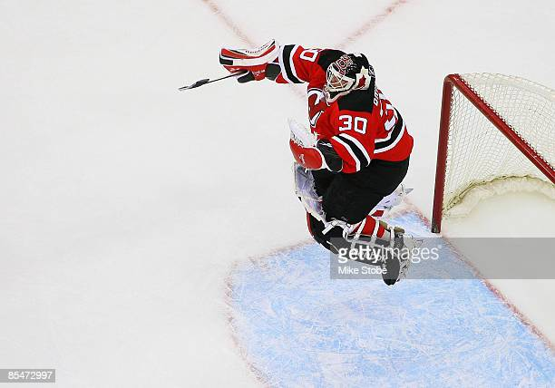 Goaltender Martin Brodeur of the New Jersey Devils celebrates after defeating the Chicago Blackhawks 3-2 and becoming the NHL's all-time winningest...