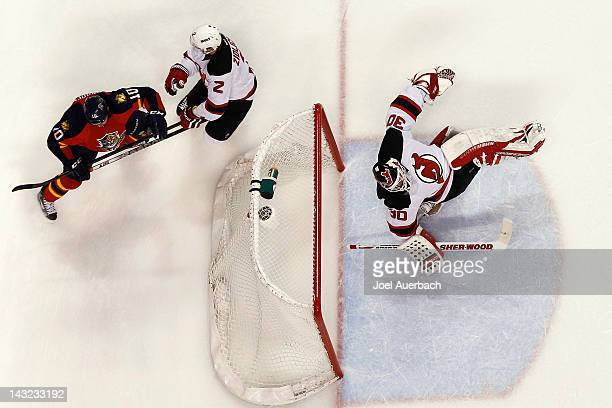 Goaltender Martin Brodeur of the New Jersey Devils dives to his right after making a save against John Madden of the Florida Panthers in Game Five of...