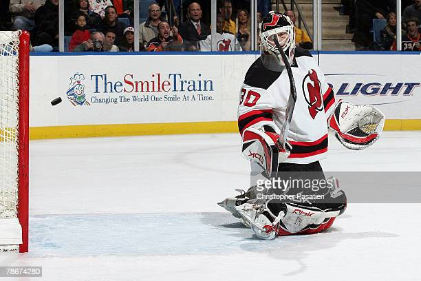 Goaltender Martin Brodeur of the New Jersey Devils gives up the game winning goal against the New York Islanders during the third period at the...