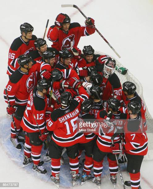 Goaltender Martin Brodeur of the New Jersey Devils is mobbed by his teammates after defeating the Chicago Blackhawks 3-2 and becoming the NHL's...