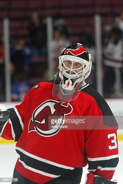 Goaltender Martin Brodeur of the New Jersey Devils looks on before the game against the Philadelphia Flyers at the Continental Airlines Arena on...