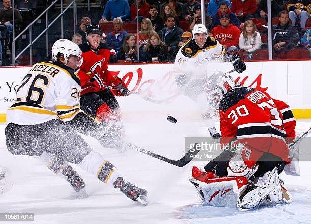 Goaltender Martin Brodeur of the New Jersey Devils makes a save on a point blank shot by Blake Wheeler of the Boston Bruins during the game at the...