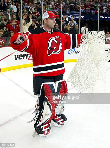 Goaltender Martin Brodeur of the New Jersey Devils skates with net and game puck in hand after defeating the Chicago Blackhawks 32 to become the...