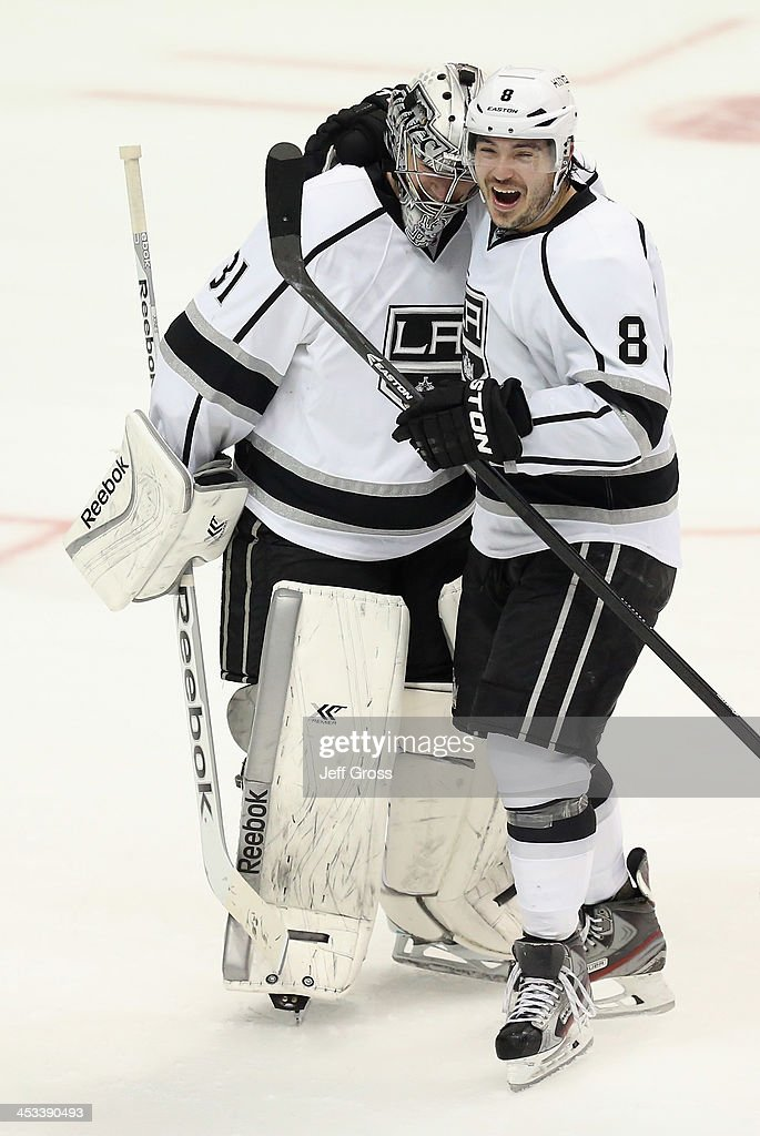 Goaltender Martin Jones (L) #31 of the Los Angeles Kings is congratulated by Drew Doughty #8 after Jones made a save on Mathieu Perreault (not pictured) of the Anaheim Ducks to win the game in a shootout 3-2 at Honda Center on December 3, 2013 in Anaheim, California.