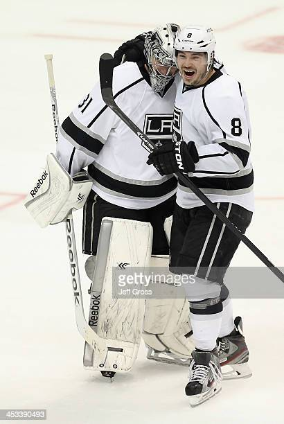 Goaltender Martin Jones of the Los Angeles Kings is congratulated by Drew Doughty after Jones made a save on Mathieu Perreault of the Anaheim Ducks...