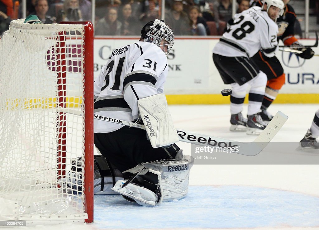 Goaltender Martin Jones #31 of the Los Angeles Kings makes a save against the Anaheim Ducks in the third period at Honda Center on December 3, 2013 in Anaheim, California. The Kings defeated the Ducks 3-2 in a shootout.