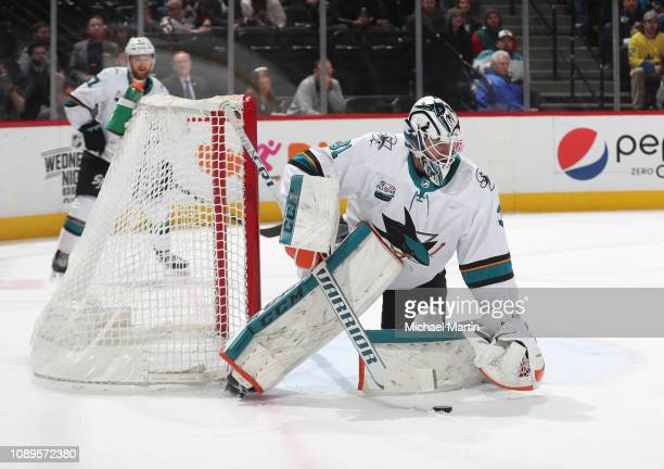 Goaltender Martin Jones of the San Jose Sharks gathers the puck against the Colorado Avalanche at the Pepsi Center on January 2 2019 in Denver...